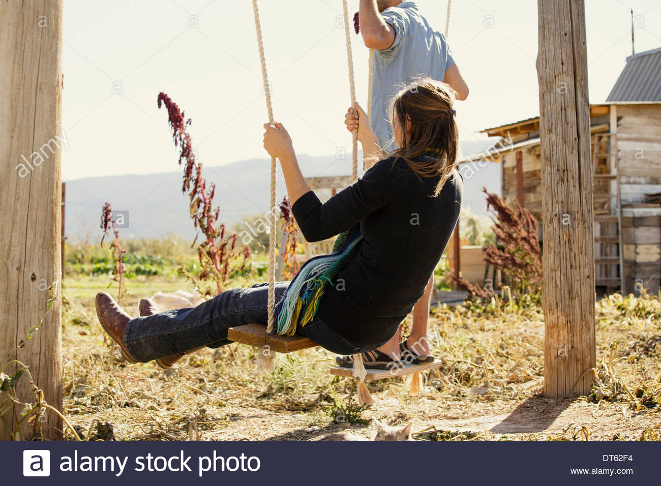 Young woman on swing - Stock Image