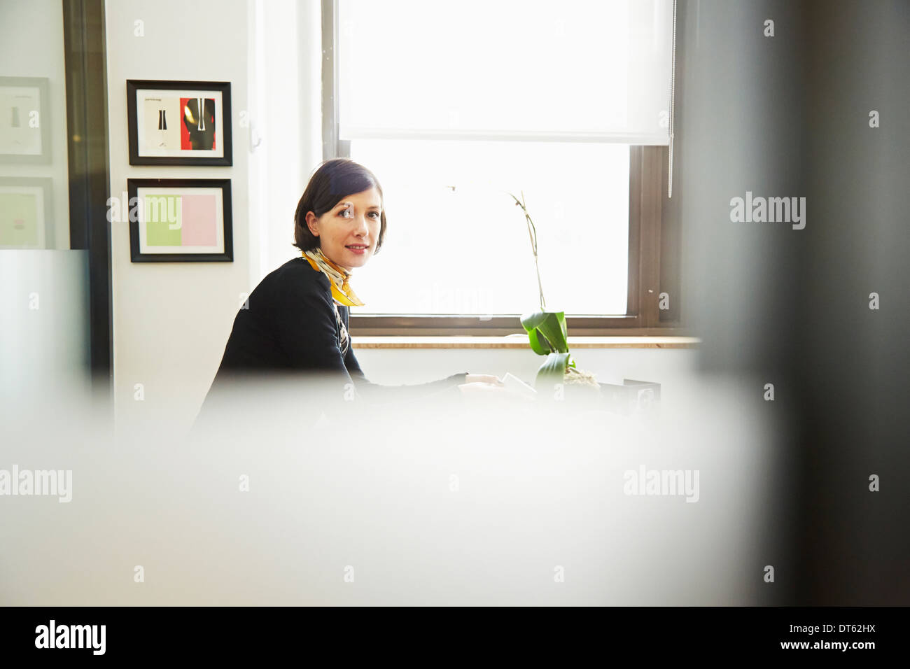 Businesswoman in office - Stock Image