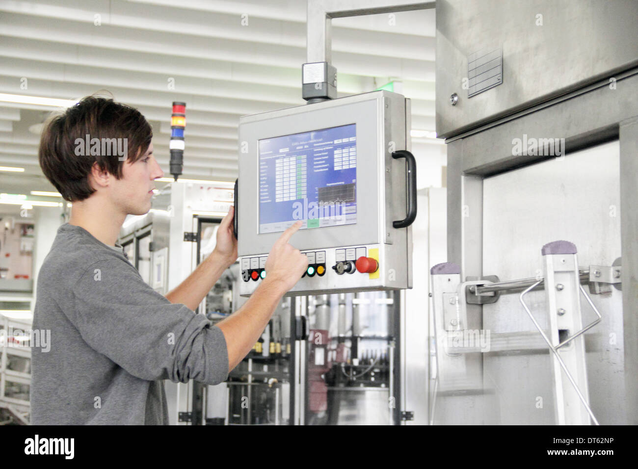 Man using control panel in brewery - Stock Image
