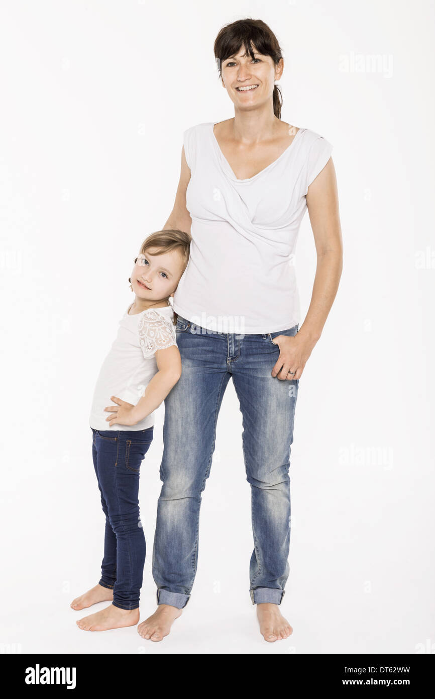 Studio portrait of mid adult mother and her daughter - Stock Image