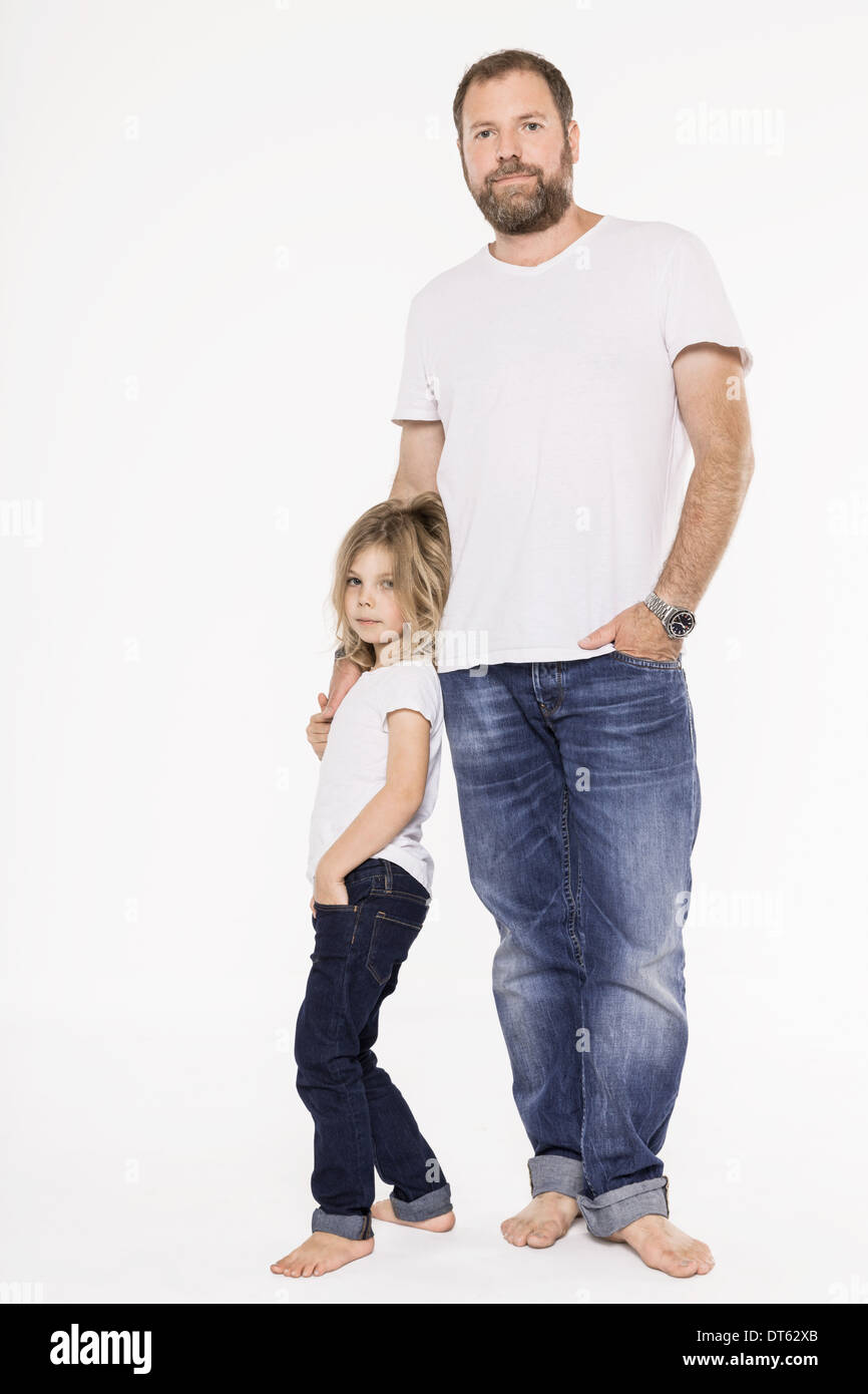 Studio portrait of mature father and his daughter Stock Photo