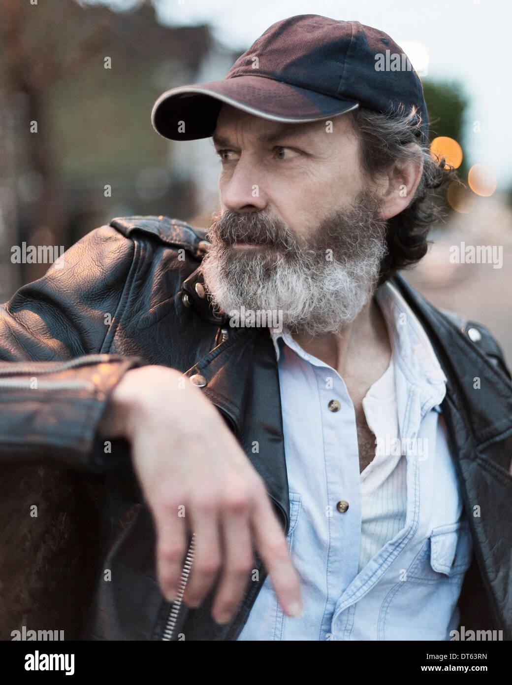 8910db950dd Mature man wearing baseball cap Stock Photo  66517577 - Alamy