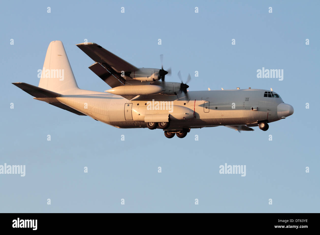 Civil-registered Lockheed L-100-30 Hercules cargo plane on final approach - Stock Image