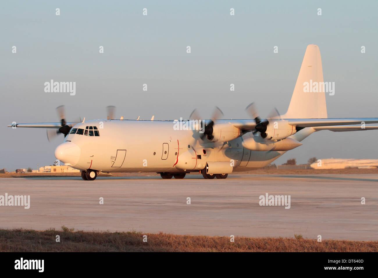 Civil-registered Lockheed L-100-30 Hercules turboprop cargo plane on arrival in Malta in transit - Stock Image