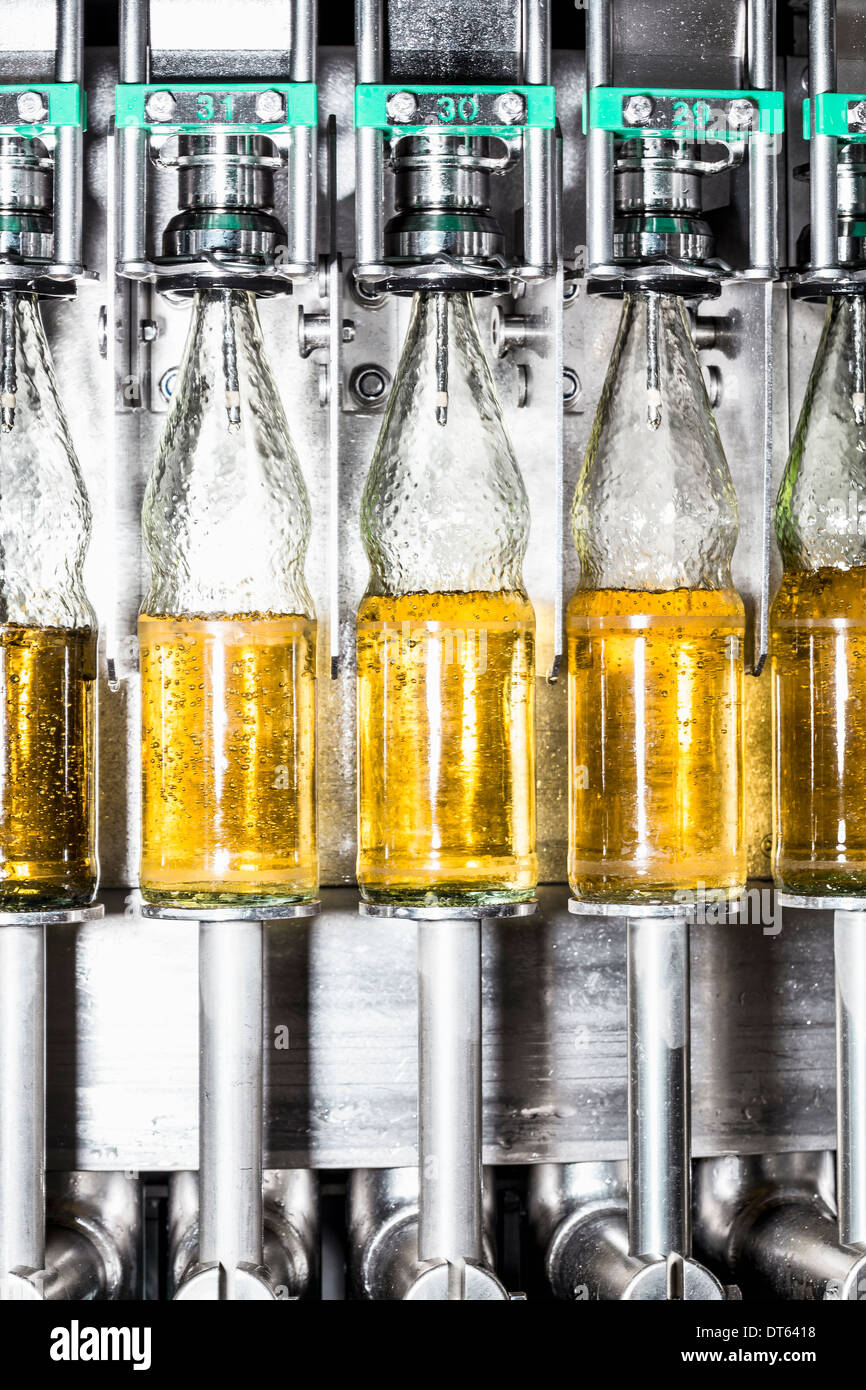 Close up of bottles on conveyor belt Stock Photo
