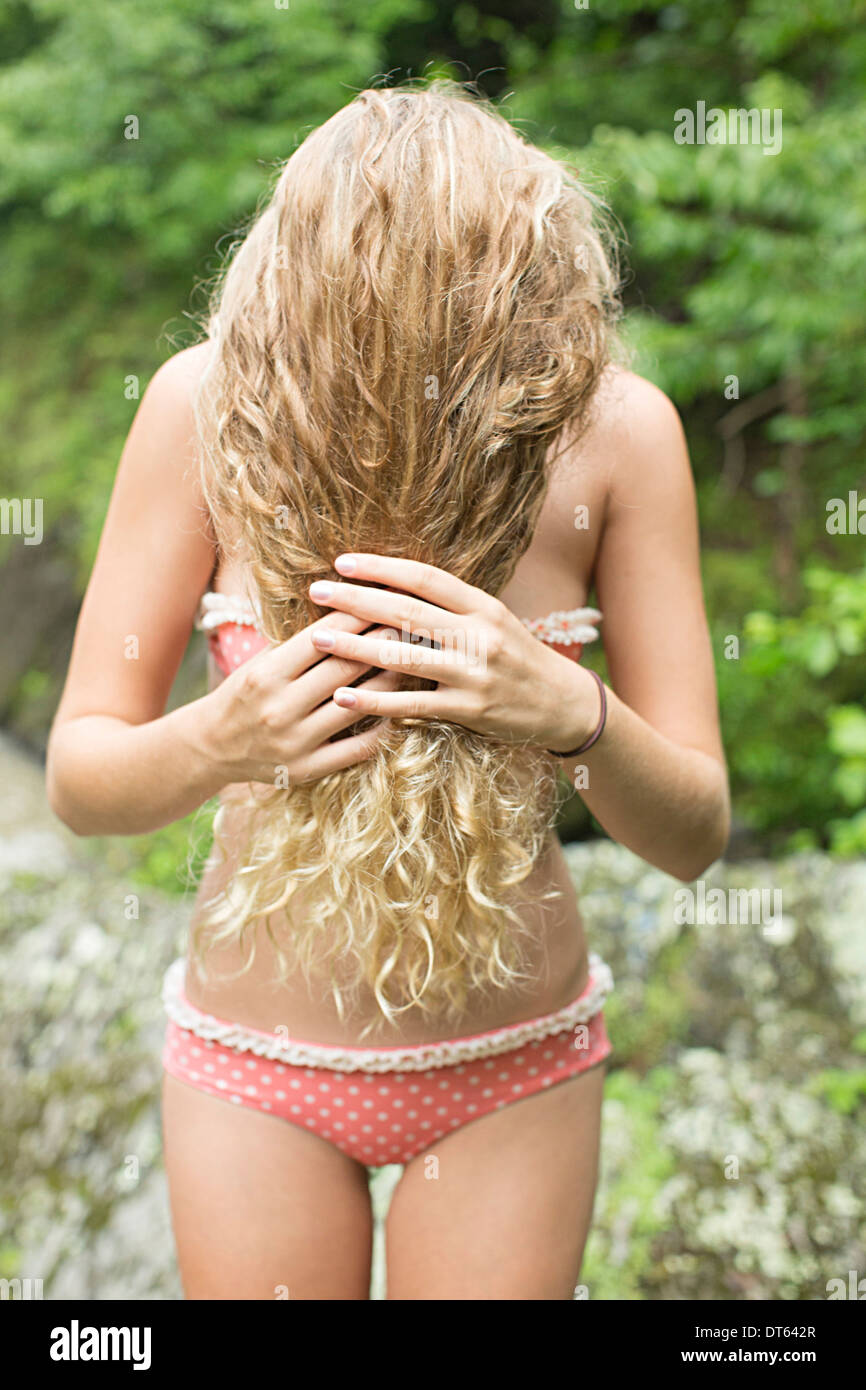 Teenage girl with hair covering face - Stock Image