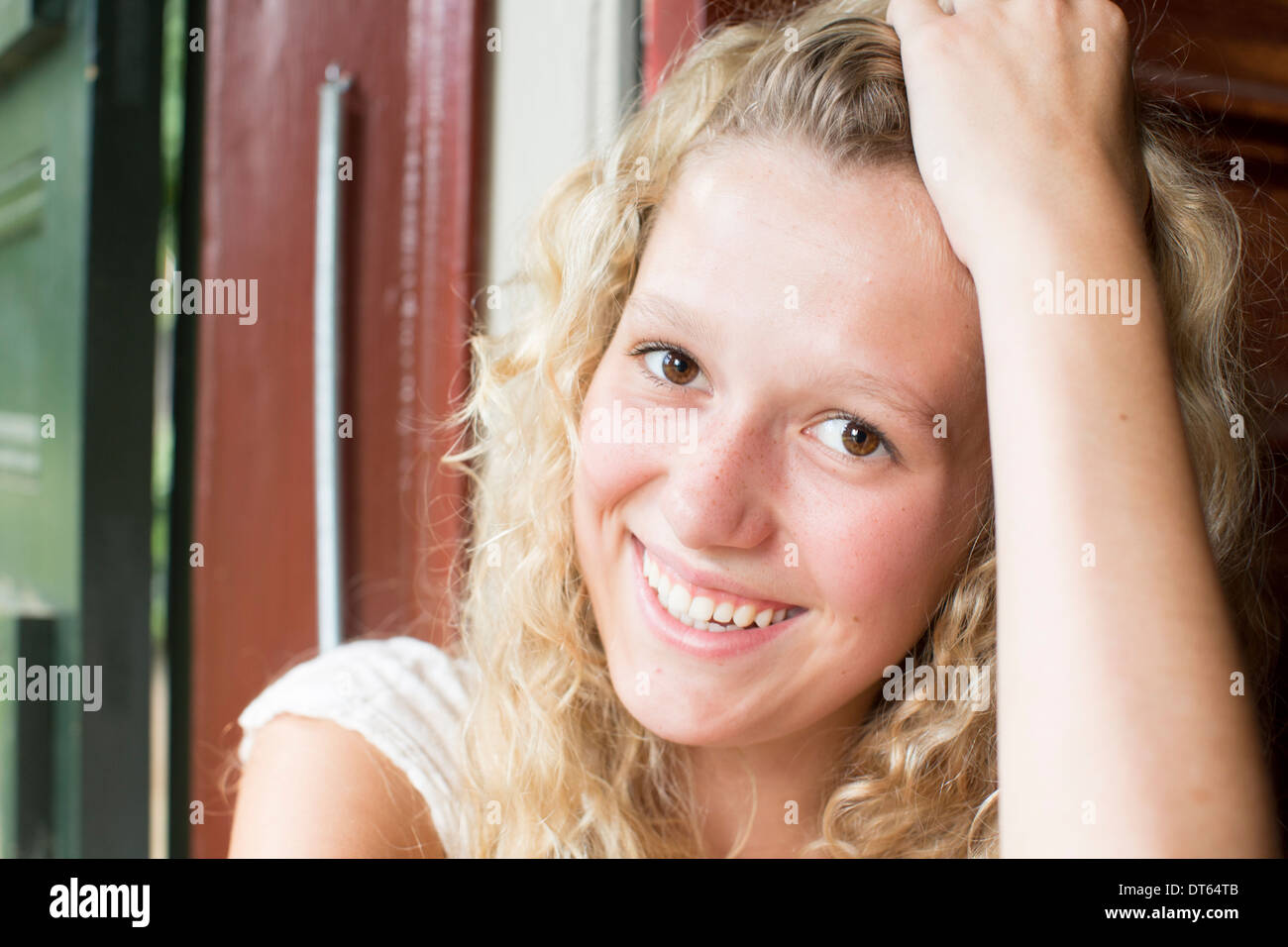 Portrait of young blonde teenager - Stock Image