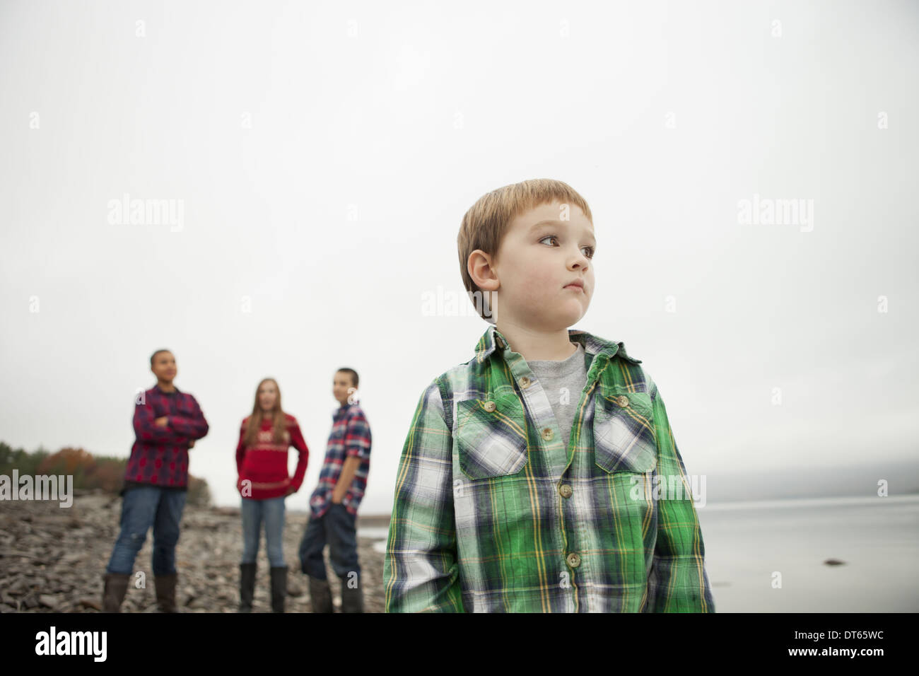 A day out at Ashokan lake. Three teenagers and a young boy on shore. - Stock Image