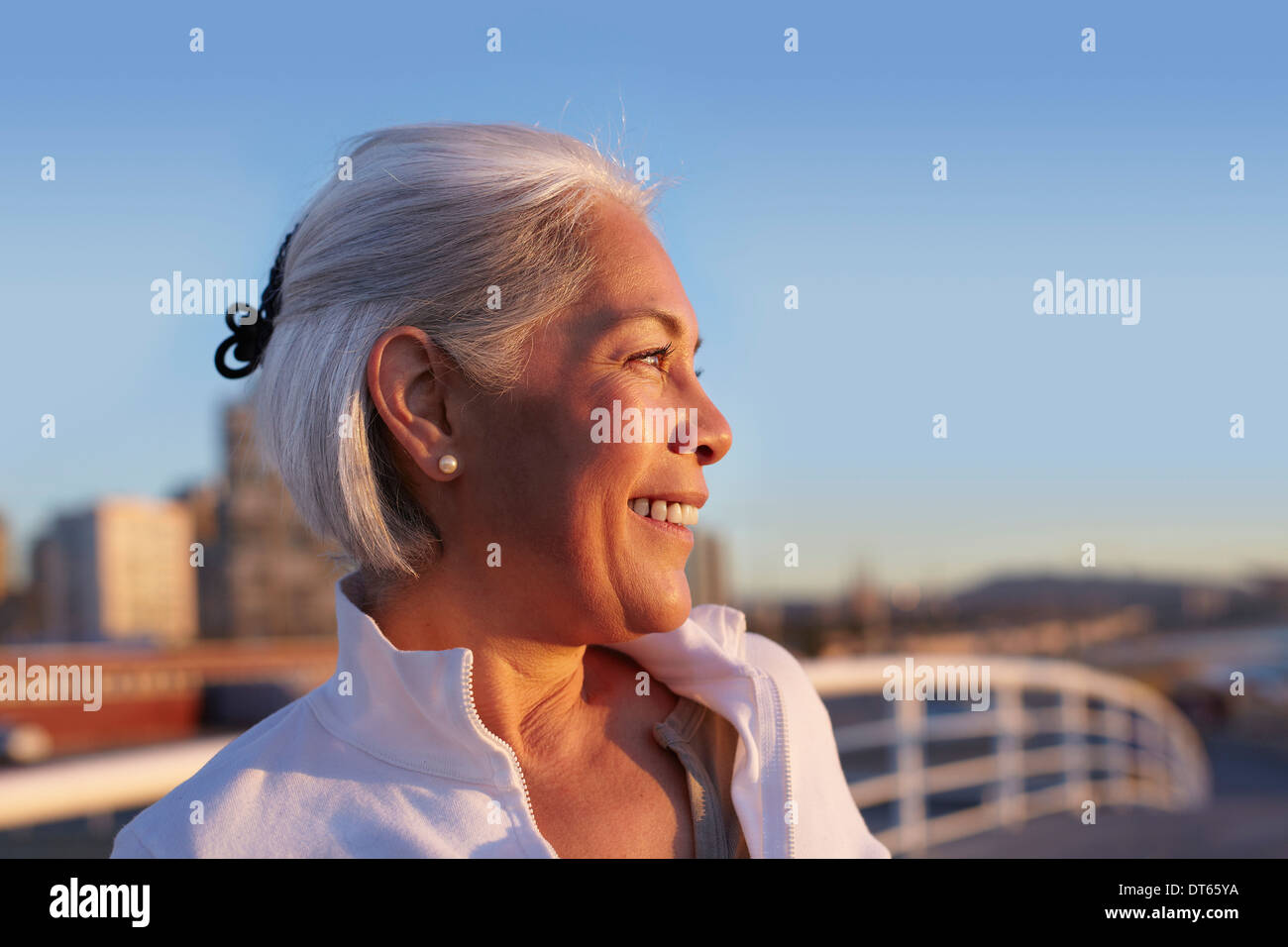 Close up profile of silver-haired mature woman - Stock Image