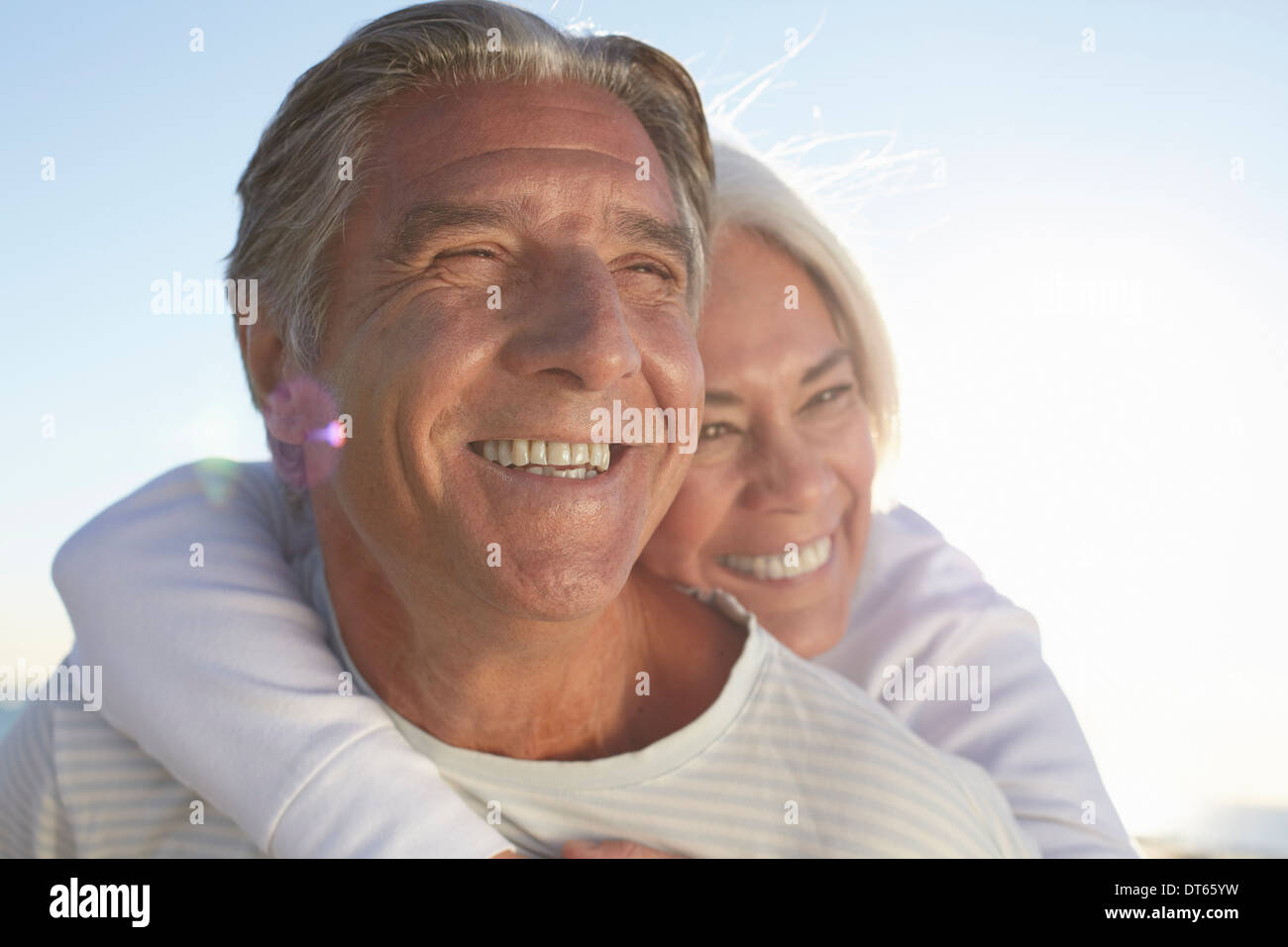 Portrait of happy couple outdoors - Stock Image