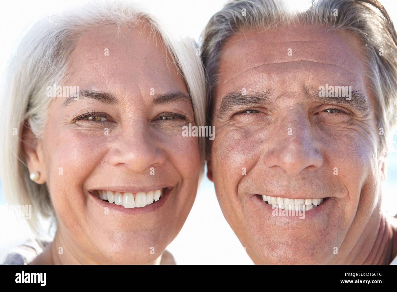 Close up portrait of happy couple - Stock Image