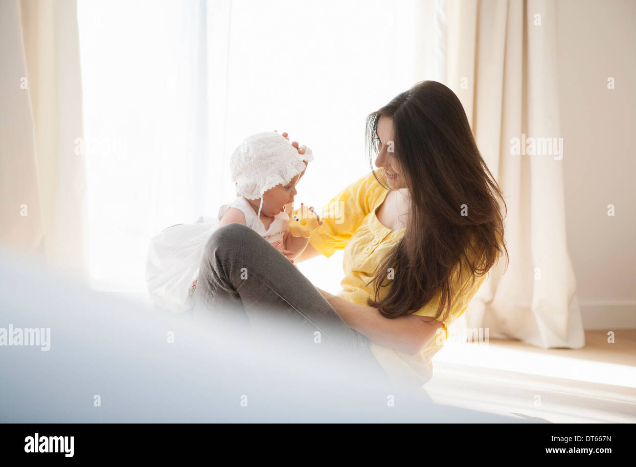 Mother playing with baby - Stock Image