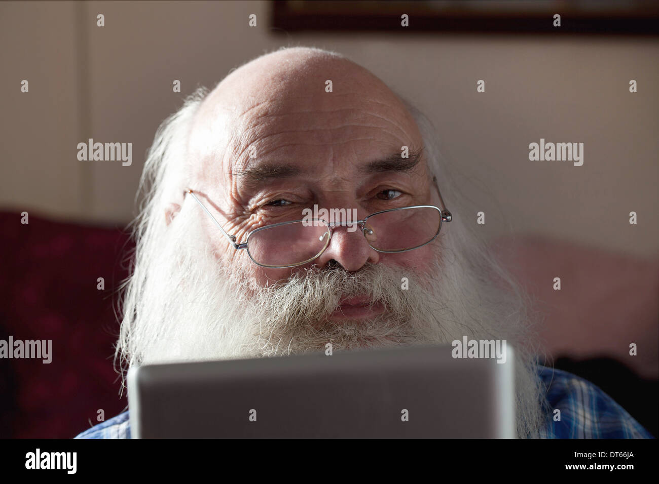 Senior man using digital tablet - Stock Image