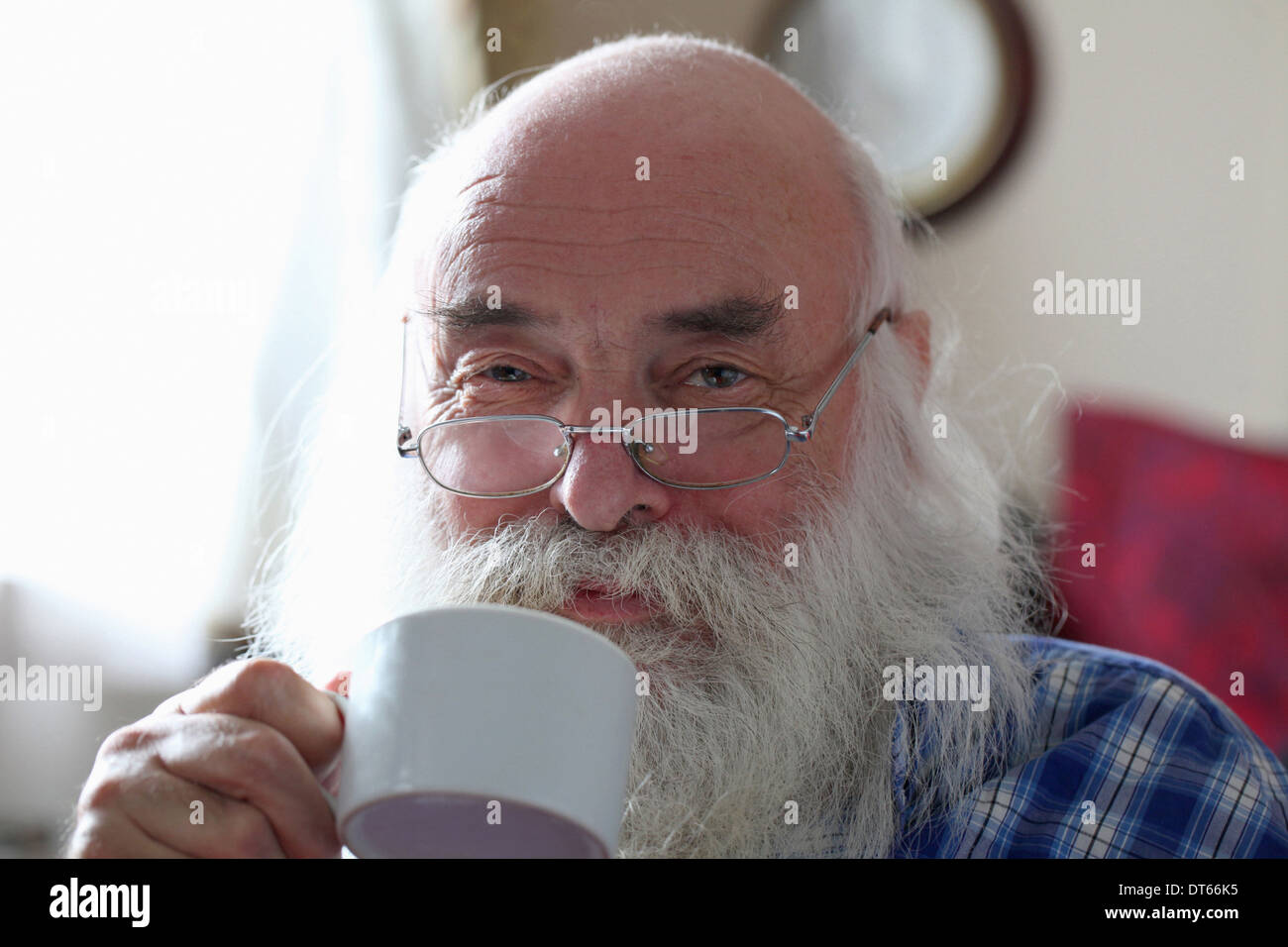 Senior man drinking tea - Stock Image