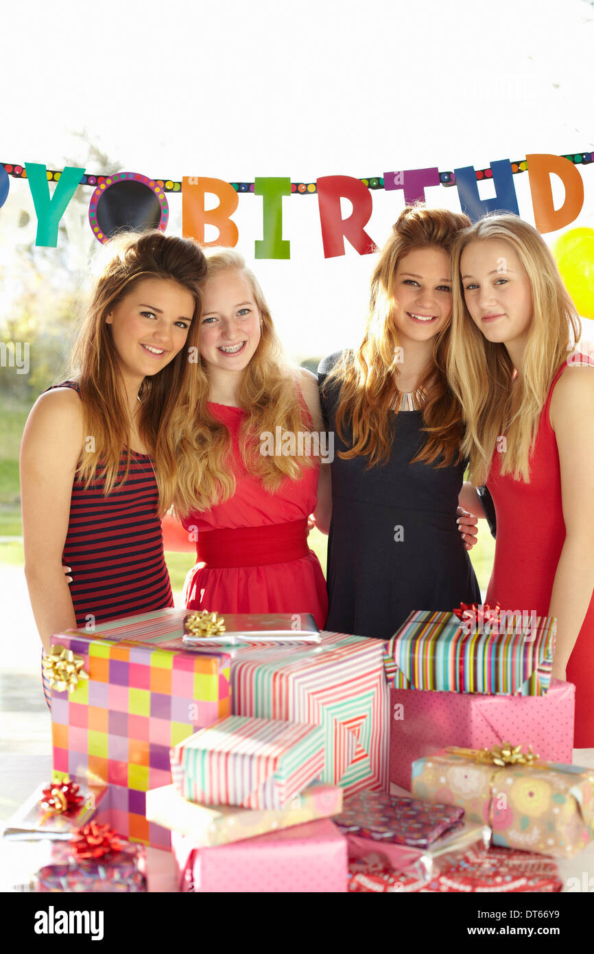 Teenage Girl And Friends With Birthday Gifts