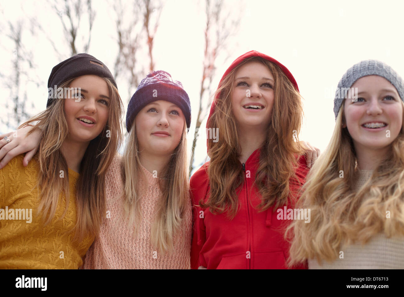 Portrait of four teenage girls in hats - Stock Image