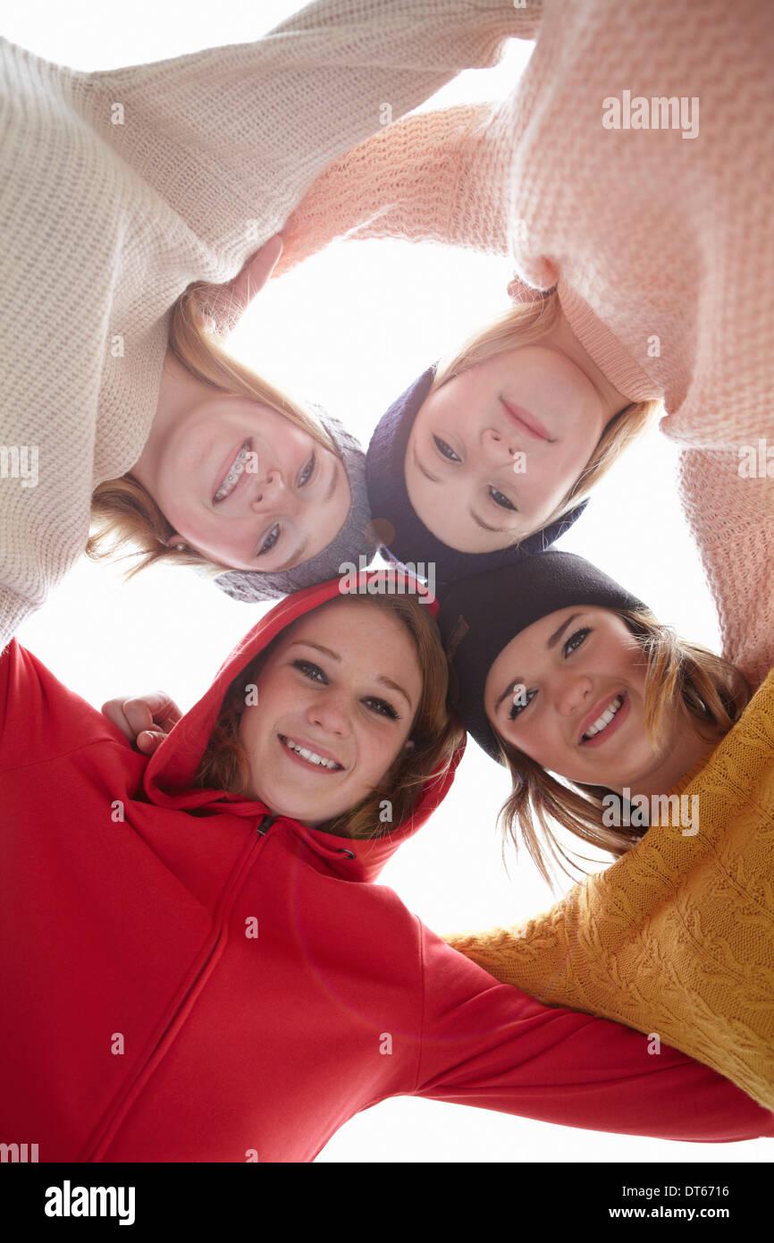 Portrait of four teenage girls head to head - Stock Image
