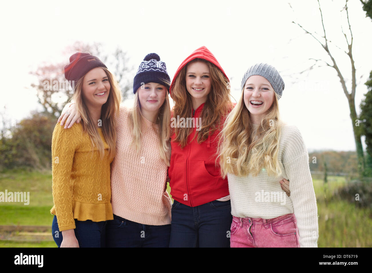 Portrait of four teenage girls in knitted hats - Stock Image