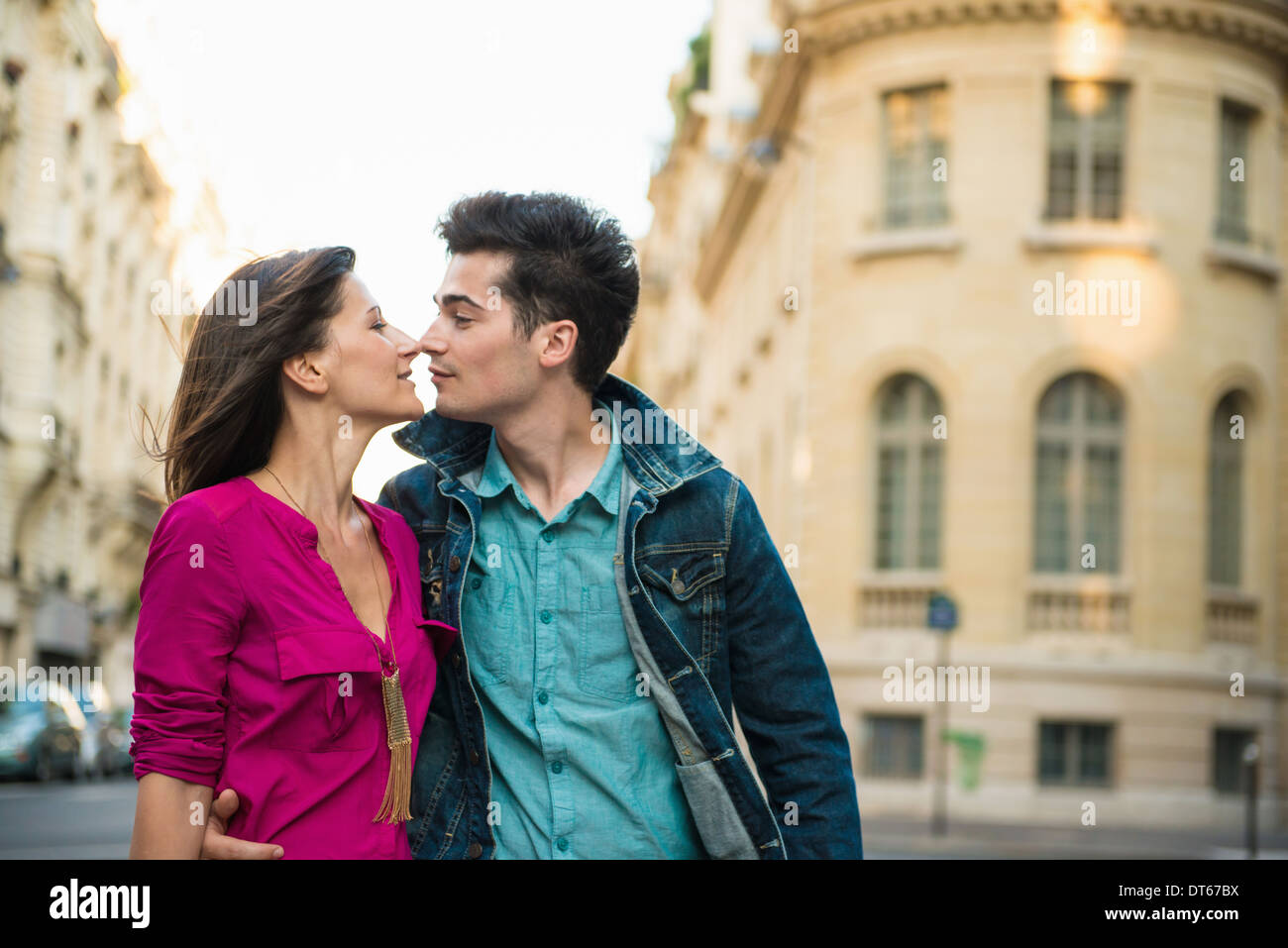 Young couple kissing on street, Paris, France Stock Photo