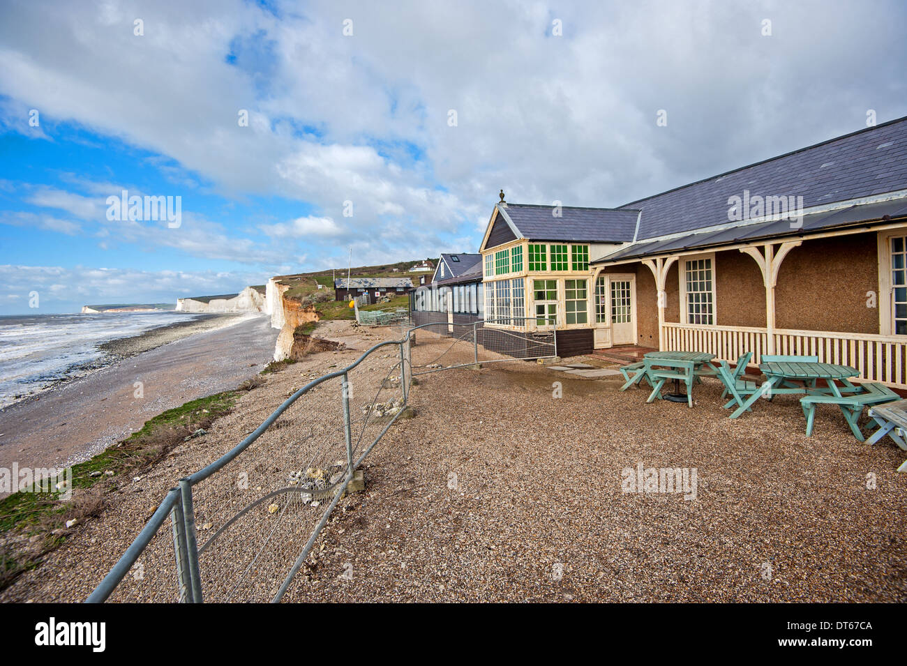 Cliffs at Birling Gap continue to erode at pace after bad weather, the cafe lost part of it's outside space during a collapse - Stock Image