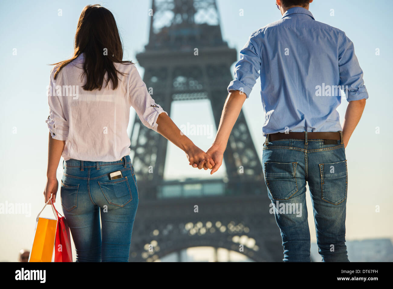 Young couple strolling in front of Eiffel Tower, Paris, France Stock Photo