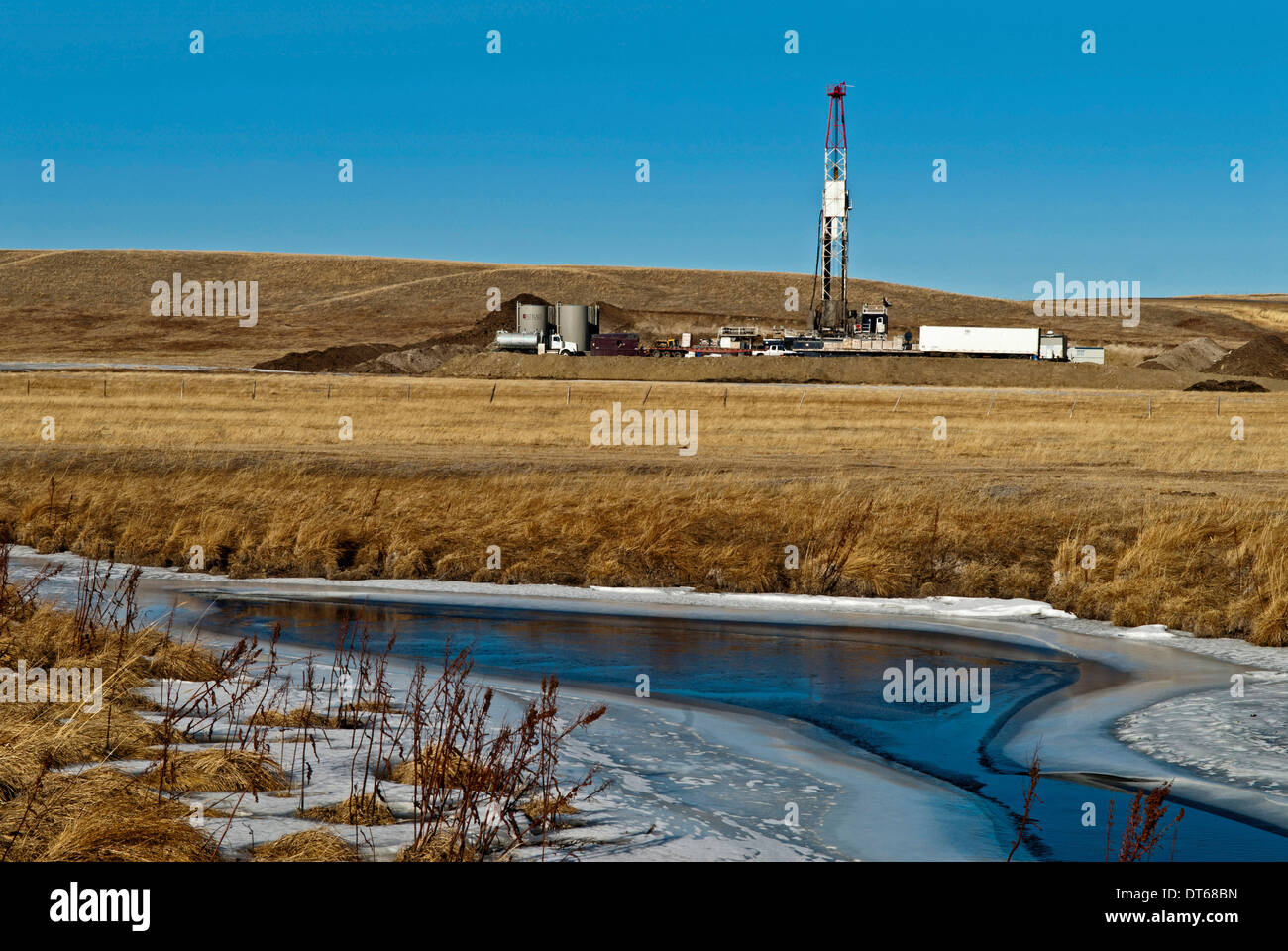 Canada, Alberta, Del Bonita, Fracking near a water source for tight shale oil and gas on the edge of the Bakken play. - Stock Image