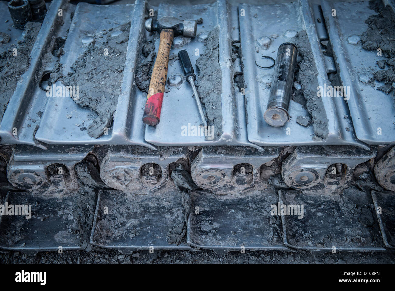 Repairs being made to bulldozer tracks at surface coal mine, close up - Stock Image