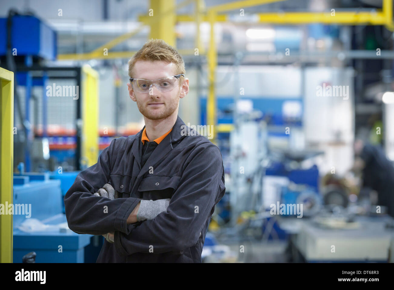 Portrait of engineering apprentice in engineering factory - Stock Image