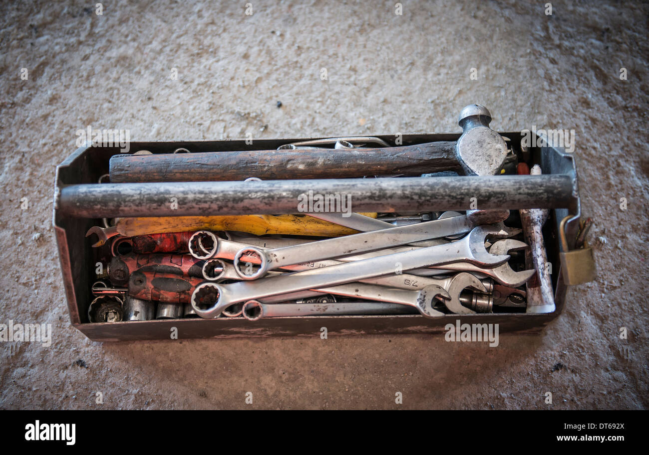 Overhead view of toolbox containing hammer and spanners - Stock Image