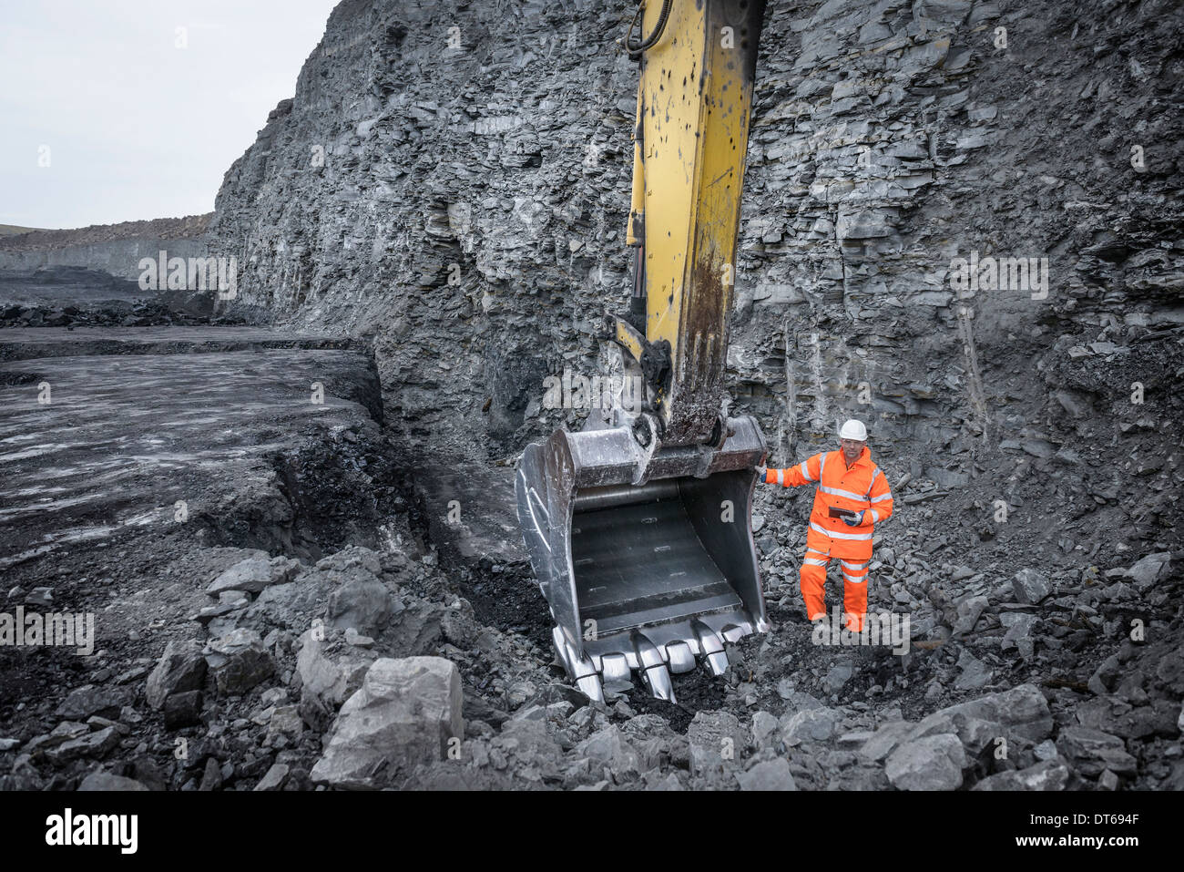 Coal miner inspects excavation in surface coal mine Stock Photo