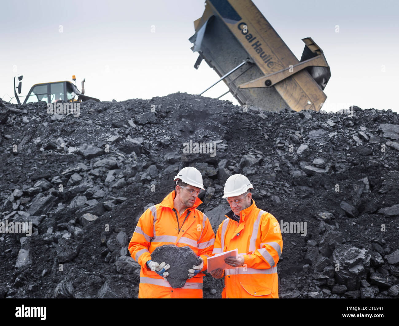 Coal miners inspecting coal in surface coal mine - Stock Image