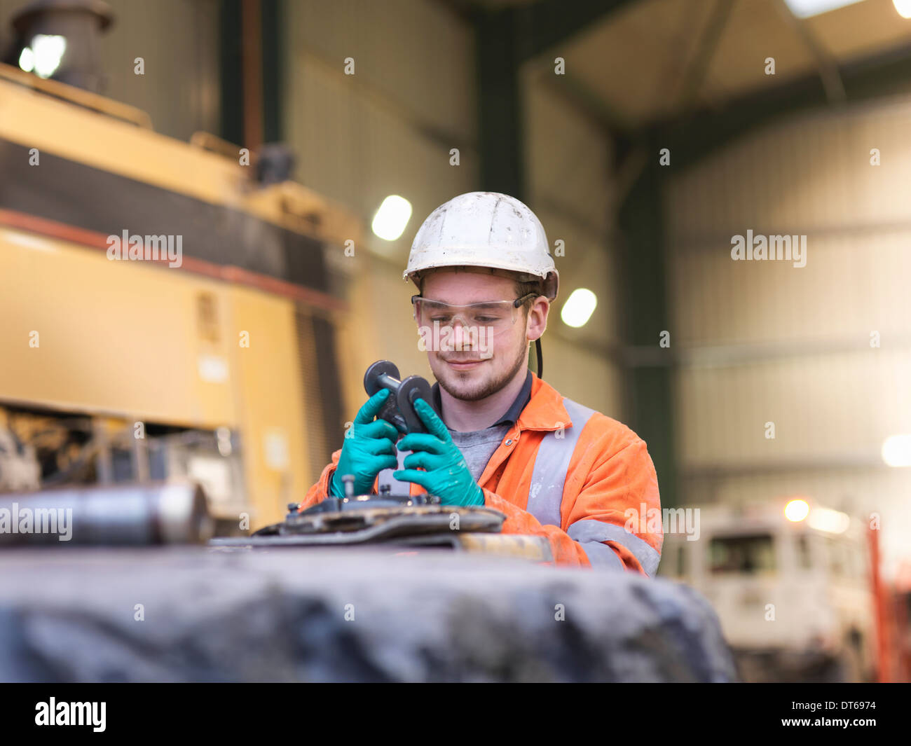 Apprentice engineer inspecting equipment in surface coal mine Stock Photo