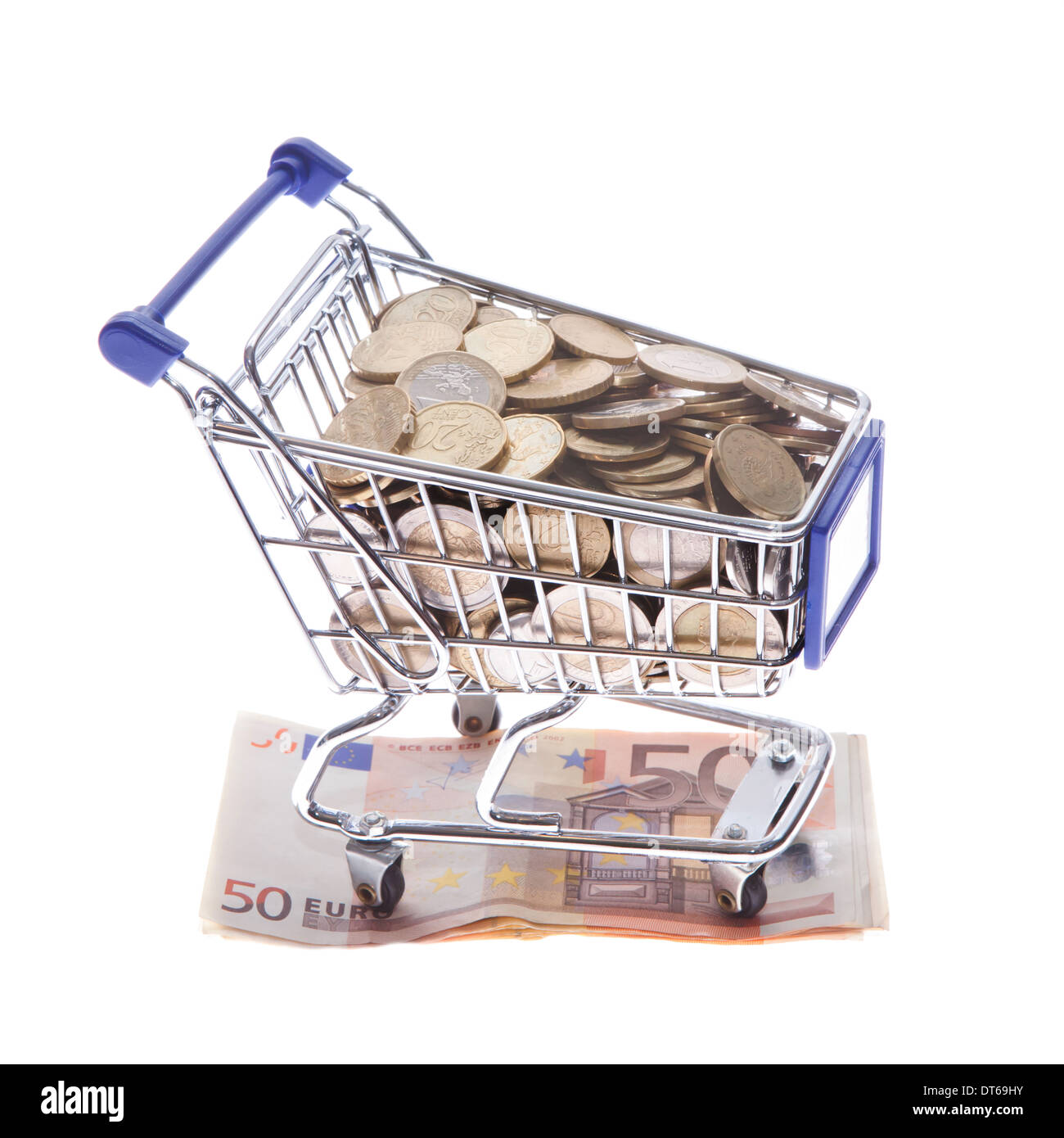 Shopping cart Euro notes and euro coins isolated on white - Stock Image