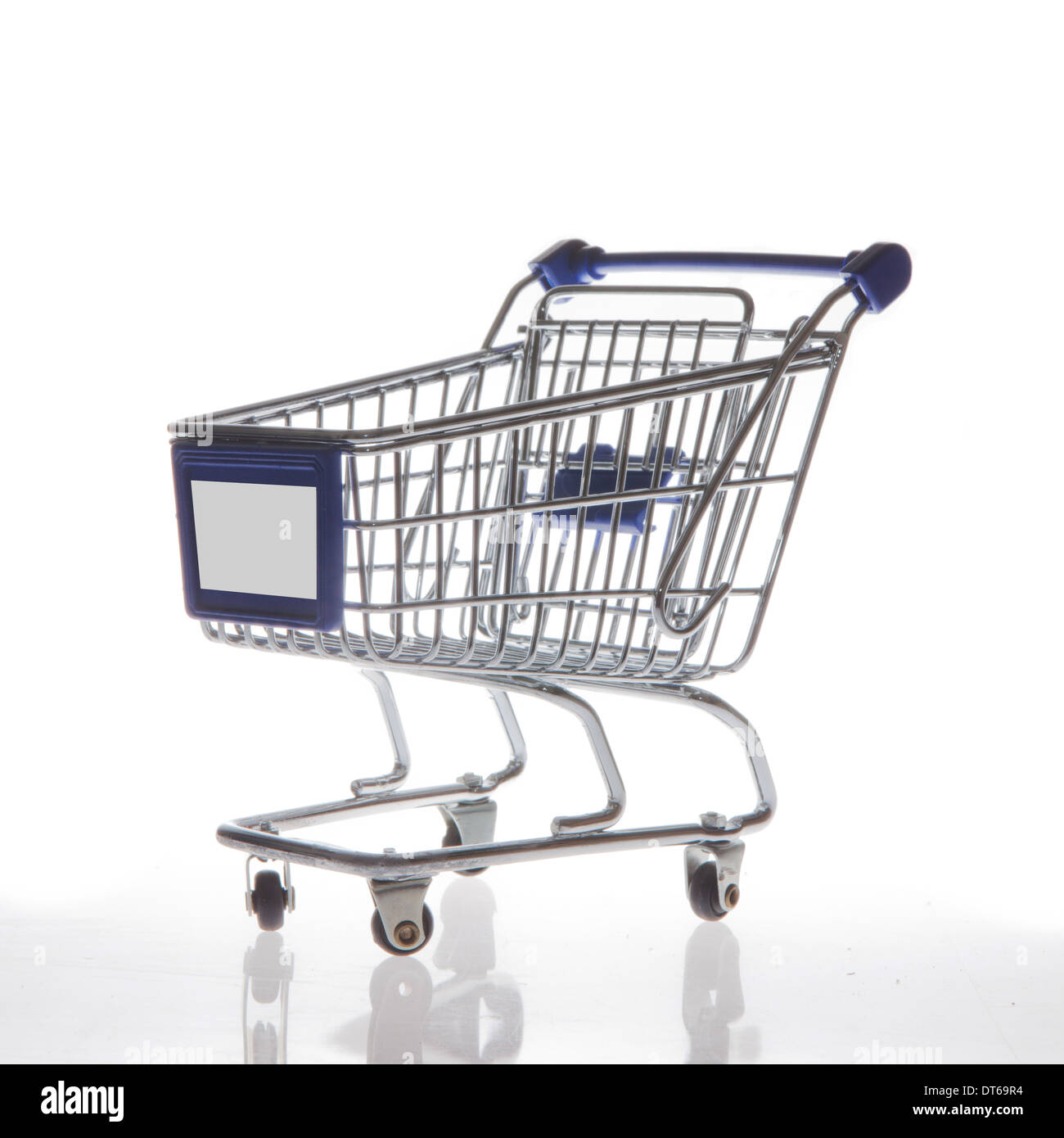 Shopping cart isolated on white side view - Stock Image