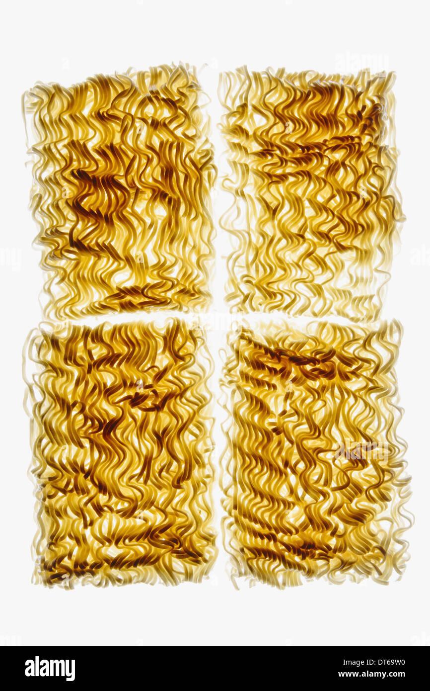 Organic (wheat flour) ramen noodles on white background - Stock Image