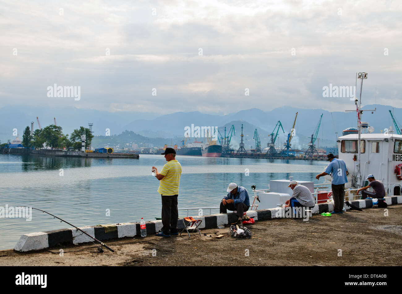 Fishermen in port of Batumi, Georgia - Stock Image