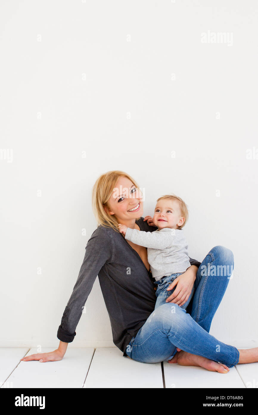 Studio portrait of mother and baby girl - Stock Image