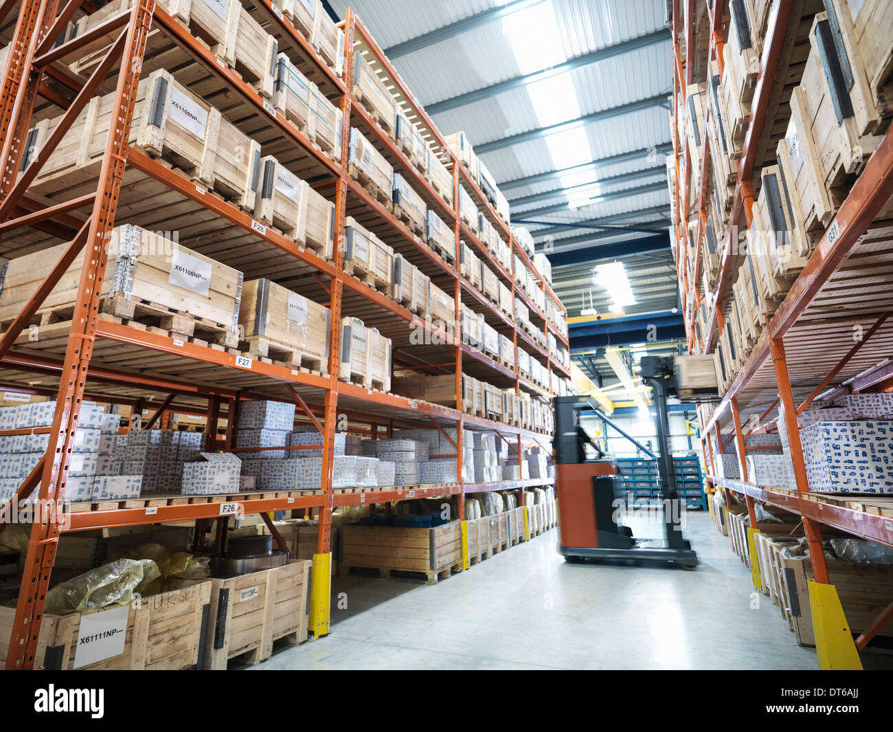 Forklift truck in parts store in factory - Stock Image