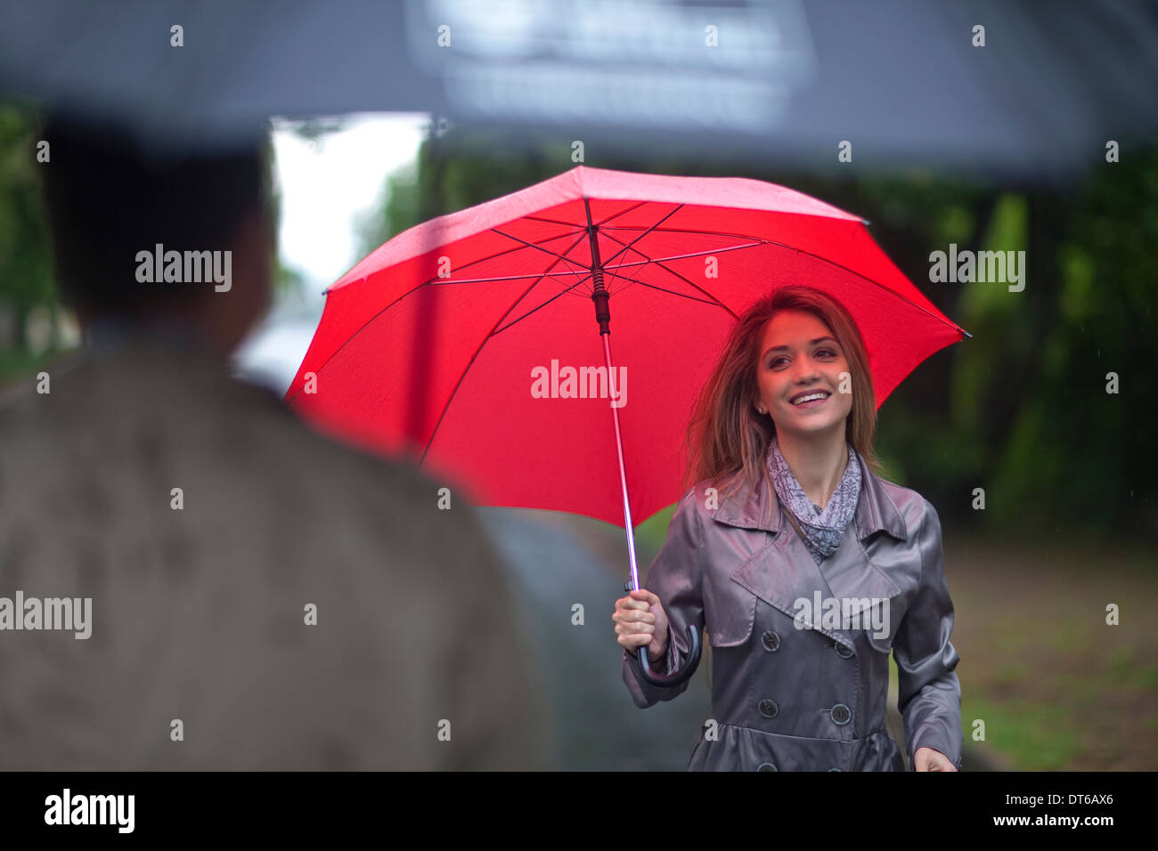 Young woman meeting man in park - Stock Image