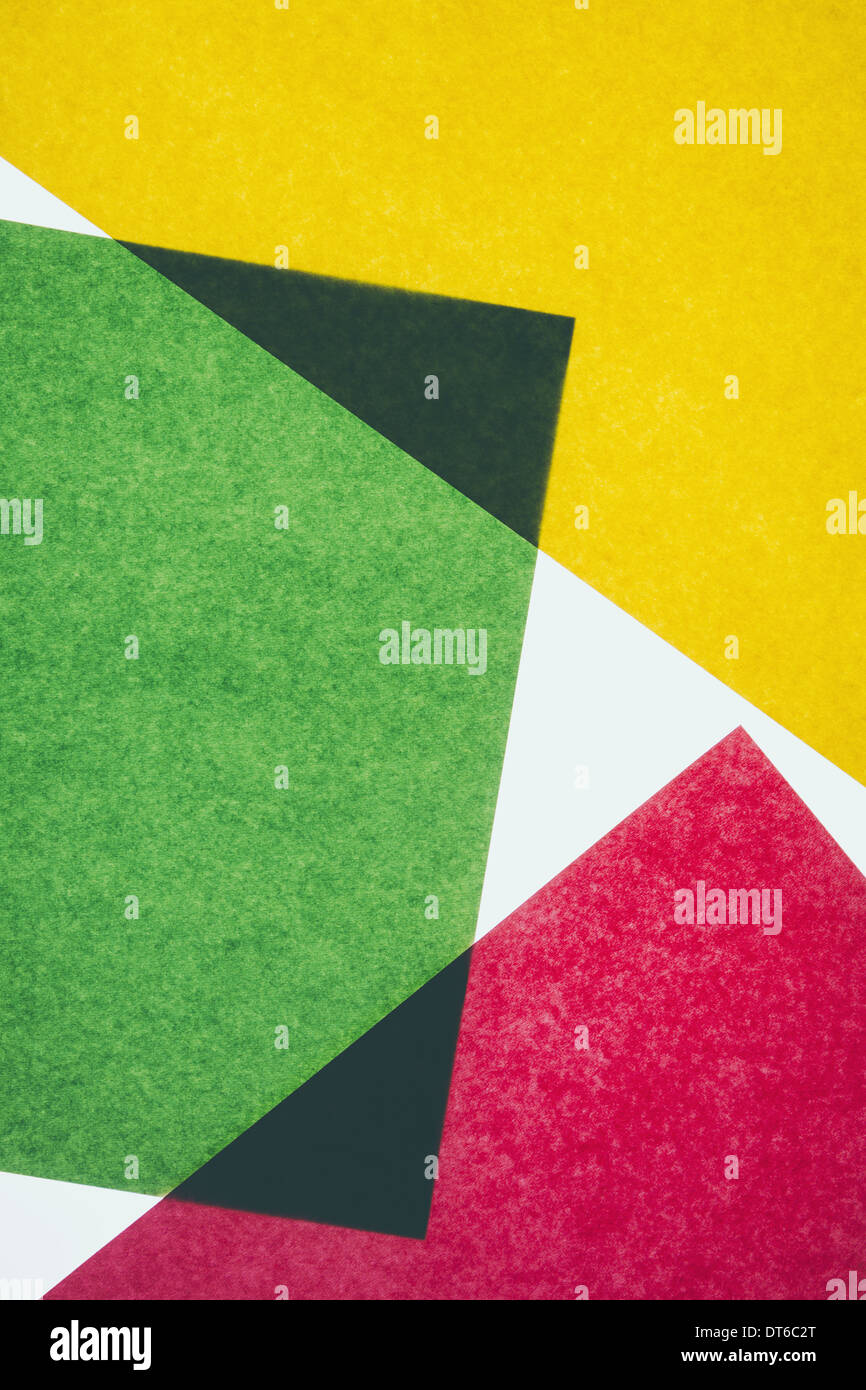 Pieces of colourful, recycled construction paper, overlapping and laid out at random. Stock Photo