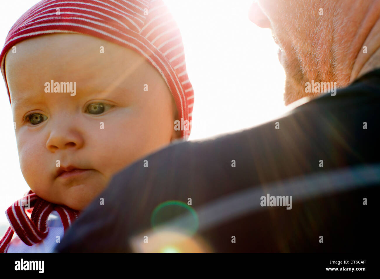 Father with baby daughter close-up - Stock Image