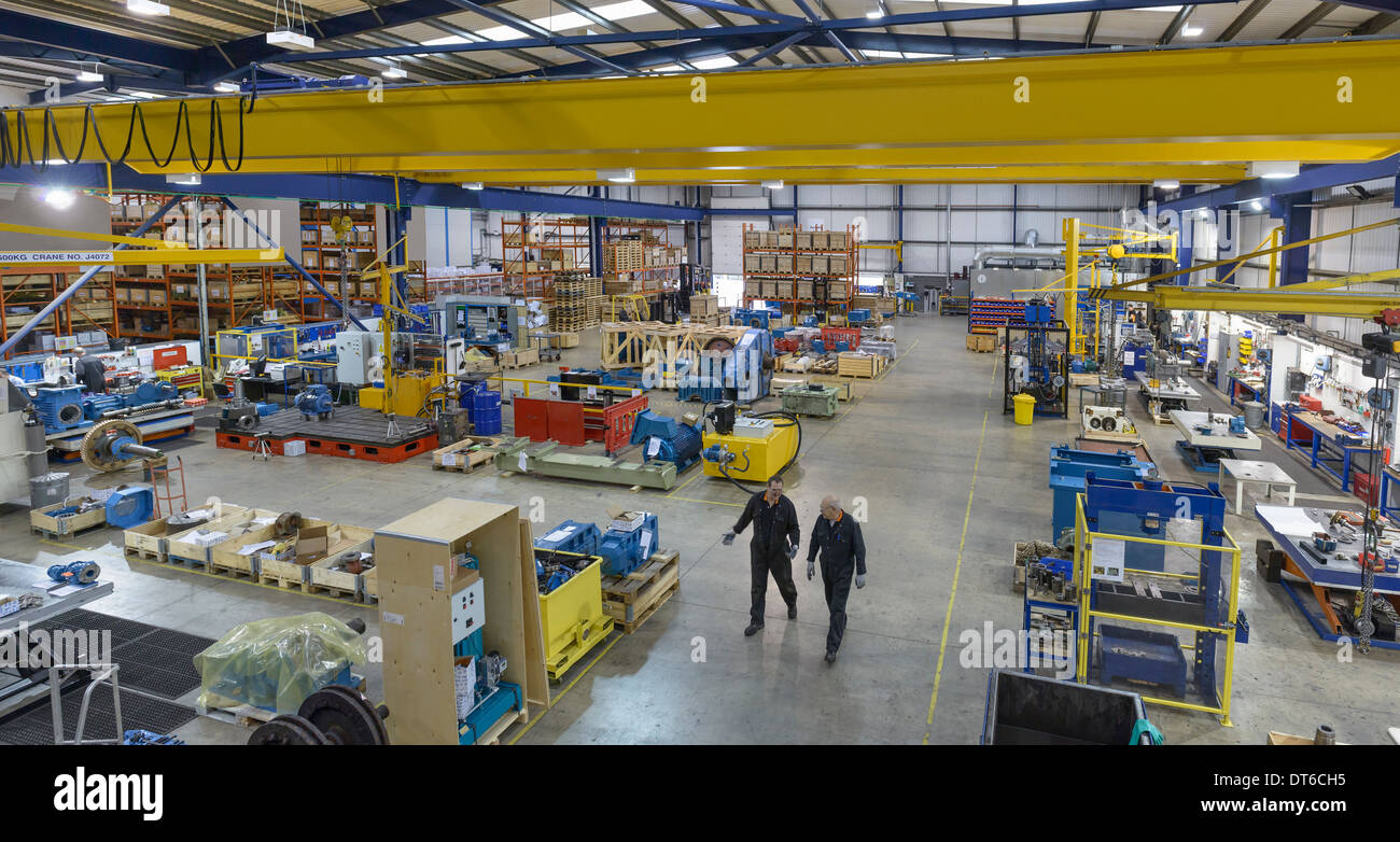 High angle view of workers in engineering factory - Stock Image
