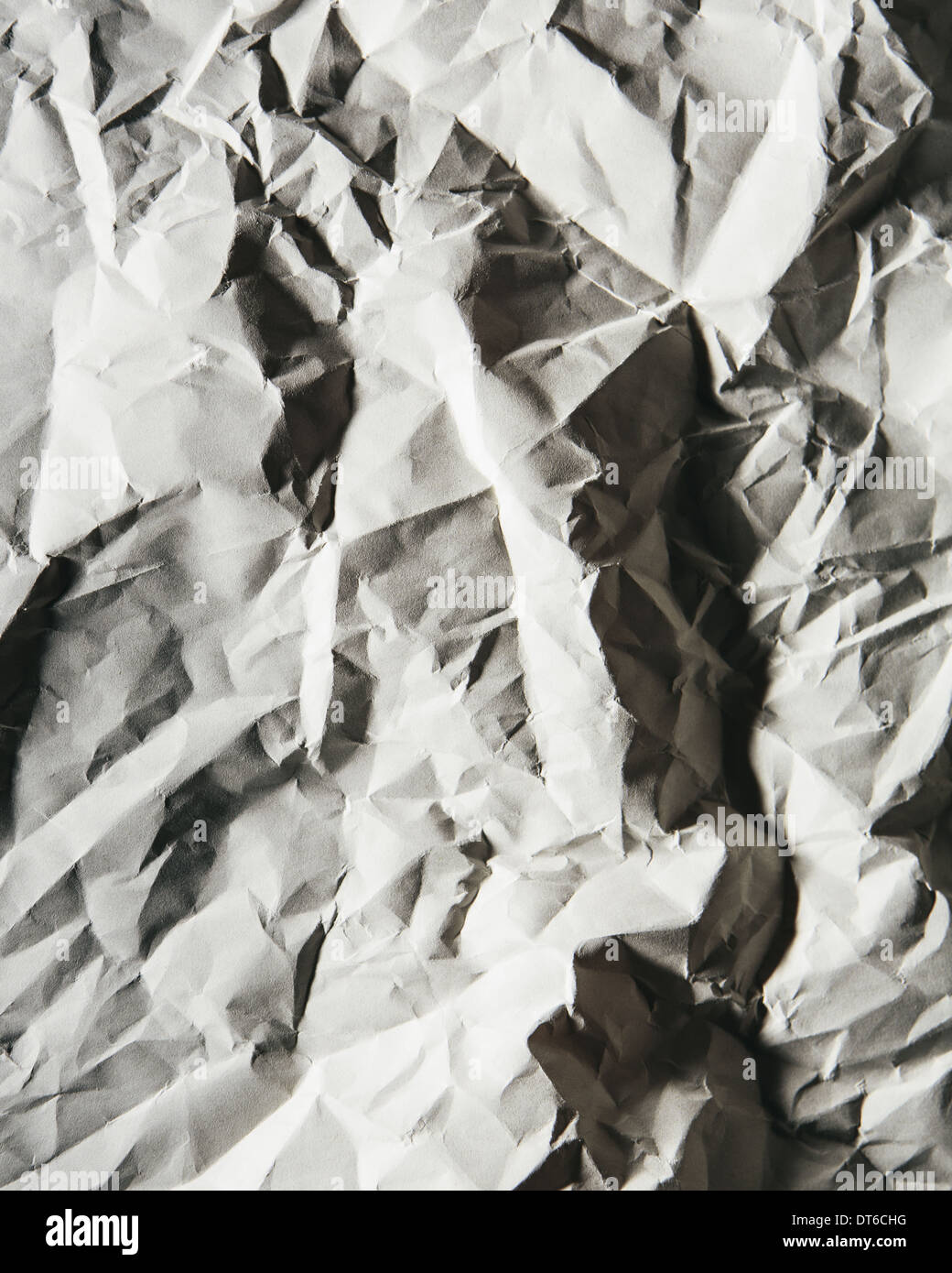 A piece of recycled white paper, crumpled and scrunched up, refuse. - Stock Image