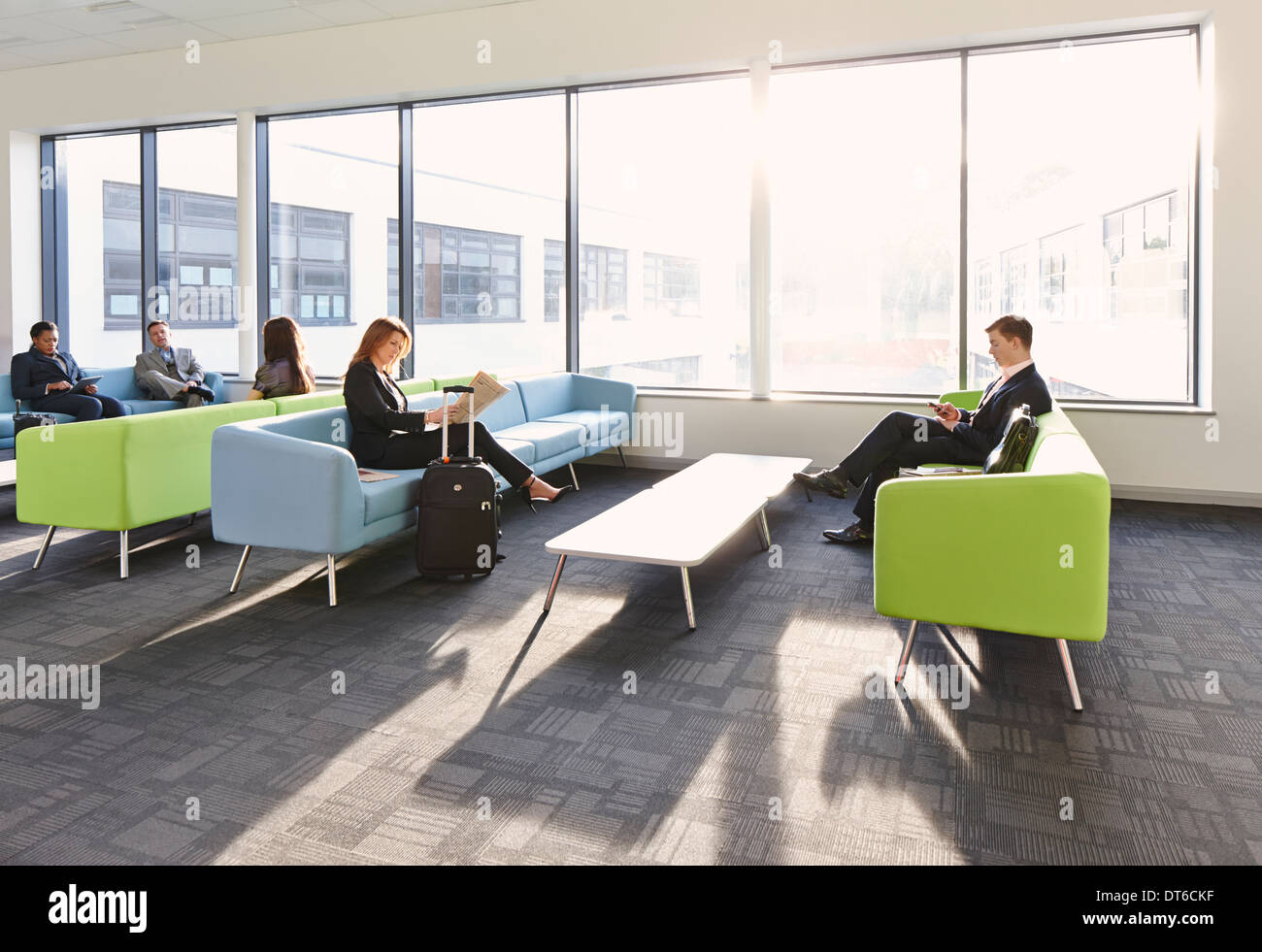 Businesspeople in departure lounge - Stock Image
