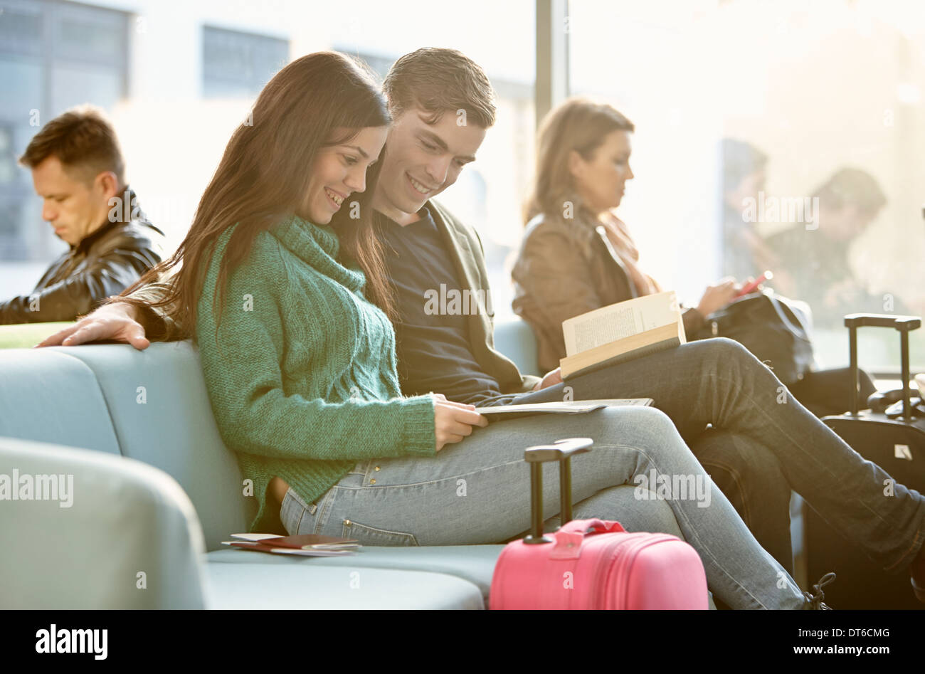 Young couple in departure lounge - Stock Image