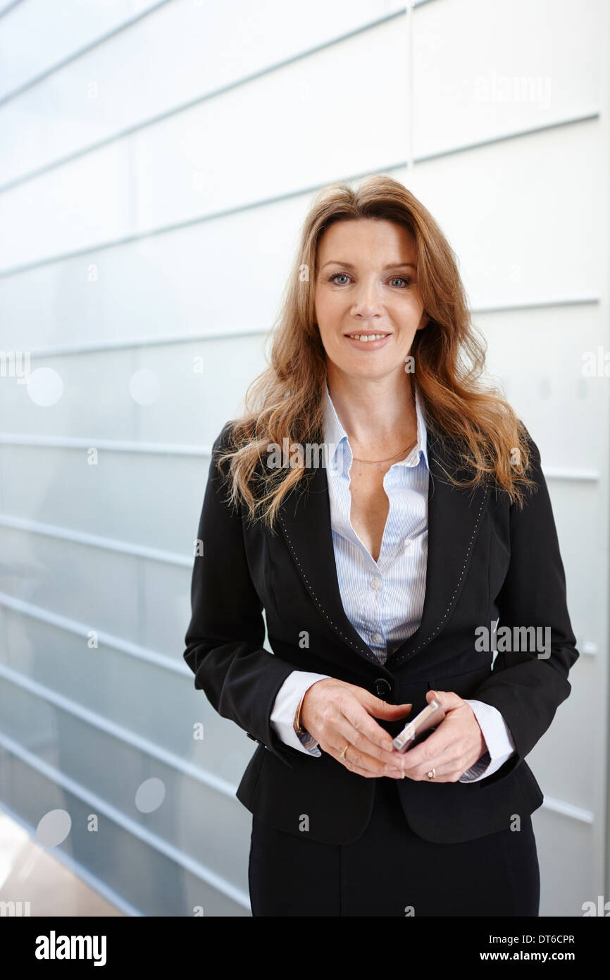 Portrait of businesswoman smiling - Stock Image