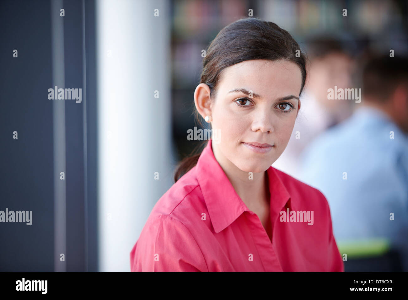Portrait of businesswoman in red blouse - Stock Image