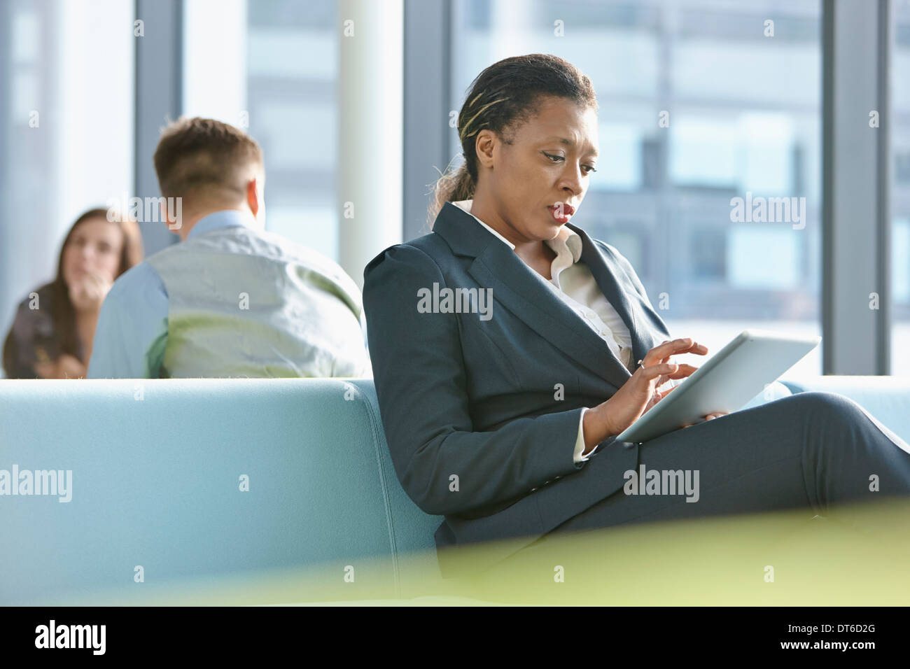 Businesswoman using digital tablet - Stock Image