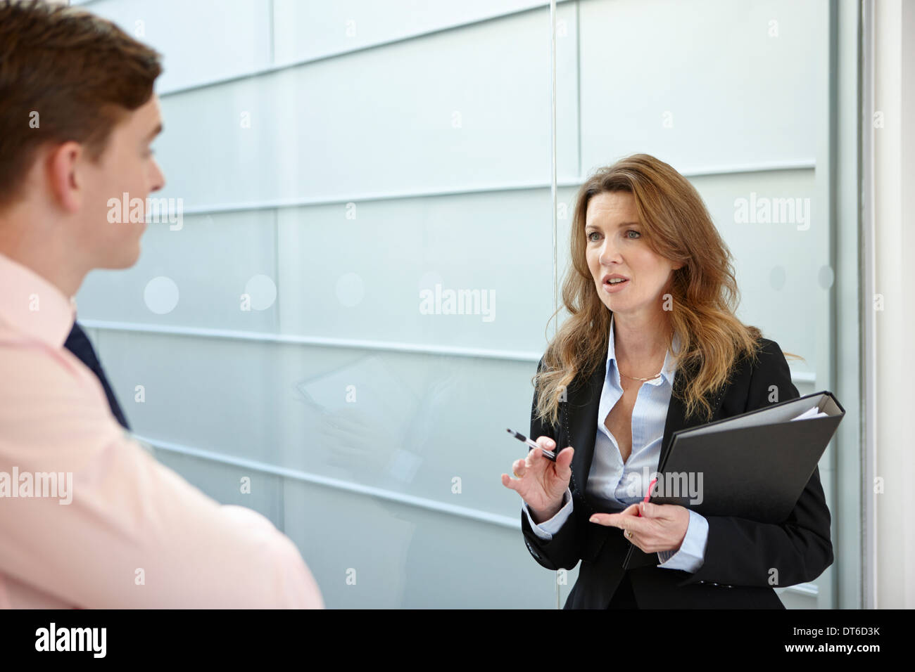 Business colleagues in discussion - Stock Image