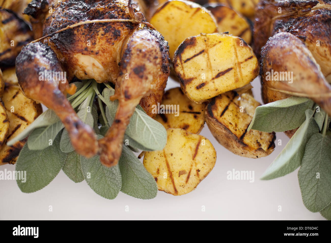 Organic free-range cooked chicken and roasted potatoes on a dish. Food for a party. - Stock Image